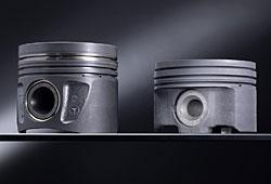 Mercedes ersetzt Alu-Kolben gegen einen aus Stahl (r.)